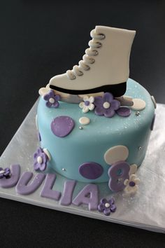 Fondant Ice Skate Cake Topper, with Polka Dots, Flowers, Name and Age Decorations for a Special Birthday Cake. $32.00, via Etsy.