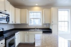 Liberty Homes, Utah home builder, kitchen, white cabinets, stainless steel appliances, kitchen island bar, granite countertops, maple cabinets. @ www.libertyhomes.com