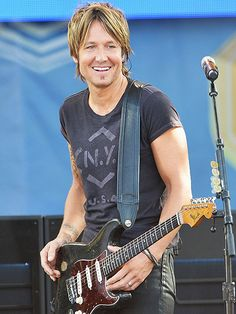 Star Tracks: Monday, July 14, 2014   STRING THEORY   Country crooner Keith Urban flashes his signature smile while performing Friday morning for Good Morning America's summer concert series in New York's Central Park.