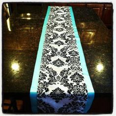 This is my inspiration right here! I saw this and knew that I was going to base everything off this! Tiffany Blue and Black and White damask table runner on VV black floor length table cloths!