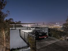 House in Reverse: Rooftop Driveway Leads to Hillside Home