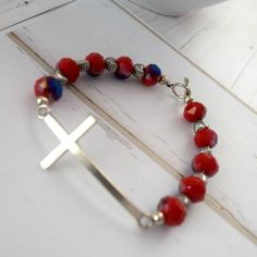 It's time to get patriotic with this sideways cross bracelet especially for you using beautiful red and blue beads, silver heart beads, and a sideways cross. #Christian #Christianjewelry #Etsy This Christian bracelet is just one of many pieces of Christian jewelry that you will want to wear. This religious bracelet has a measurement of 7 inches (17.78 centimeters) This patriotic bracelet is a beautiful reminder to pay tribute to those individuals and families that have sacrificed for our…