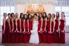 Red strapless bridesmaids dresses.