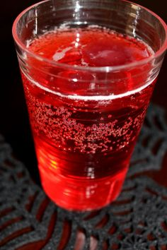Dust Witch Punch 1 part white grape juice 1 part sparkling cider grape juice grenadine Fill the spider ice cube trays with grape juice and freeze at least six hours. Pour the white grape juice and sparkling cider in a punch bowl with the spider ice cubes. Add a splash of grenadine to each cup then a serving of the punch. Serve the punch in transparent cups so the kiddos can watch the purple spiders bob.  The spider grape juice ice cubes will melt pretty quickly. Perhaps grape koolaid would f
