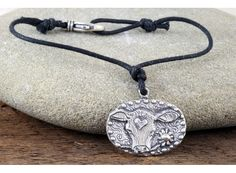 """""""Live with Compassion,"""" engraved on back of Jes MaHarry's pewter 'Sweet Jane' medallion was designed to honor one of the most recent additions to her ranch; an orphaned 'wet-calf.' Jes also dedicates this charm to the rescued cow (and also mascot) at The Gentle Barn – """"Buddha."""" 50% OF ALL PROCEEDS FROM THIS BRACELET ARE DONATED TO THE GENTLE BARN (www.gentlebarn.org)."""