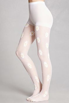 A pair of sheer knit tights featuring allover daisy appliques, a control top, and an elasticized waistband. This is an independent brand and not a Forever 21 branded item.