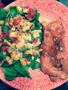 Salmon with honey, soy sauce, maple syrup, garlic cloves, salt, pepper  400 degrees for 20 minutes  Mango pineapple salad : mango, pineapple, avocado, red pepper, yellow pepper, red onion, tomatoes, lime, salt, pepper, spinach