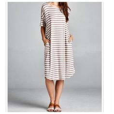 Striped dress with pockets Chic loose fit striped chic dress with pockets Light jersey knit available in mocha and white stripes only PLEASE USE Poshmark new option you can purchase and it will give you the option to pick the size you want ( all sizes are available) BUNDLE And SAVE 10% ( sizes updated daily ) Dresses