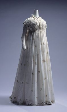 """Round Gown: ca. 1795, Italian, embroidered muslin, lace trim. """"From elegant silk dress to simple cotton dress, the French Revolution in 1789 brought a clear shift in clothing styles. The popularity of white cotton muslin dresses became a craze at the beginning of the 19th century. The round gown has a high waistline reaching just below the bust, with the bodice and the skirt connected to form a one-piece dress."""""""
