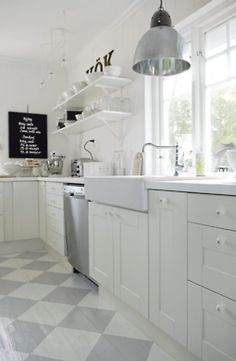 Gorgeous Swedish kitchen with white cabinets, open shelving, farmhouse sink (IKEA?), industrial style pendant, and gray checkerboard painted wood floors. Swedish Kitchen, New Kitchen, Kitchen White, Kitchen Wood, Country Kitchen, Kitchen Interior, Vintage Kitchen, Swedish Cottage, Stainless Kitchen