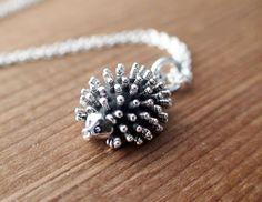 I love unique silver pendants!