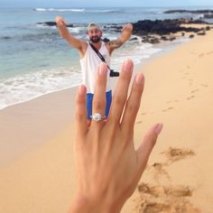 Amazing round engagement ring and the perfect engagement photo!