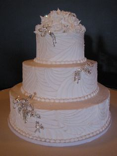White glittery web pattern on a wedding cake with bling selected by bride.  Buttercream icing and web. www.VintageBakery.com  (803) 386-8806