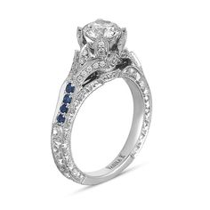 VannaK.com This unique engagement ring from the Hand Engraved collection is decorated with 0.15 ct. t.w.  sapphires and 0.18 ct. t.w. diamonds, pictured (1.0 ct. center not included) Hand-Engraved by expert artisans for the perfect profile combiningwhite hand-selected diamonds to maximize the sparkle from the center stone. The Hand-Engraved collection was created to last a lifetime and beyond