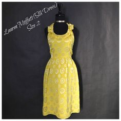 This is a gorgeous summer dress! Made by the Lauren Moffattbrand, this lovely yellow beauty is made of silk. The dress is 90% silk and 10% rayon, the inner lining is 100% silk. The dress has a rounded neck line, a ruffle collar, a tie around the neck, tie around the waist and is knee length.    The dress is a size 2 with the following measurements:    MEASUREMENTS    - Length: 37 inches    - Bust: 17 inches    - Waist: 26 inches    This item ships immediately to US addresses. 📦 Also…