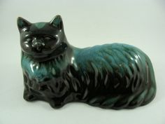 Blue Mountain Pottery Persian Cat that is lying down. This cat is approximately 7.5 inches long and 4.5 inches high. It is in perfect condition with no chips,cracks, crazing or other defects.