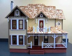 Now this is a dollhouse! Check out the website, beautiful selection of home made dollhouses!
