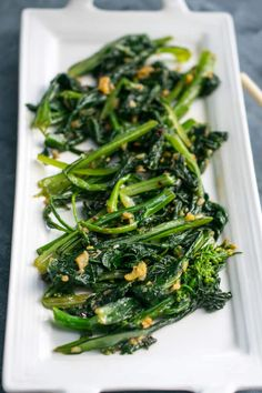 A guide to the leafy green vegetable choy sum, also known as cai xin or Chinese flowering cabbage, and an easy recipe for chili garlic stir-fried choy sum. Garlic Recipes, Stir Fry Recipes, Fish Recipes, Vegan Recipes Videos, Vegan Recipes Easy, Vegetarian Recipes, Steamed Vegetables, Fruits And Veggies, Cooking Vegetables