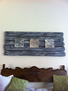 Needed a large art piece for a wall in my living room so I made this from old fence boards. It goes with my cottage look I'm going for.