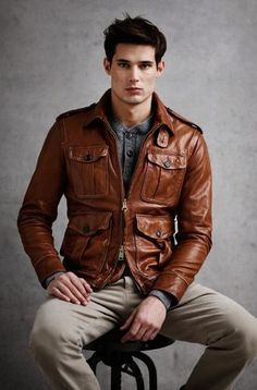 "Rock a brown leather field jacket with tan chinos for a casual-cool vibe.   Shop this look on Lookastic: <a href=""https://lookastic.com/men/looks/brown-leather-field-jacket-grey-cardigan-khaki-chinos/14415"" rel=""nofollow"" target=""_blank"">lookastic.com/...</a>   — Grey Cardigan  — Brown Leather Field Jacket  — Khaki Chinos"