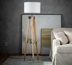 Finally, there is room for lighting and storage at the end of the sofa without a cluttered side table. This tripod lamp features an updated classic style and a built-in tray that's the perfect place to drop the remote or a pair of reading glasses.