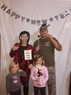 Our photo booth was a huge success for New Years!!! Plain white sheet and some funny face wood signs from Amazon!!!