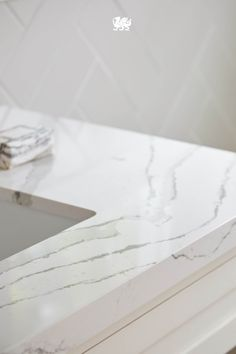 Brittanicca offers a velvety marbled background of neutral white while gray streams meander among intertwining ashen veins dotted with veiled charcoal sparkles. // Featured Design: Brittanicca from Cambria's Marble Collection