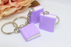 Book keychain, Polymer clay book charm, Pastel purple book, I love to read, Polymer Clay Disney, Polymer Clay Charms, Purple Books, All Things Purple, Violet Pastel, Clay Keychain, How To Make Clay, Diy Clay, Clay Tutorials