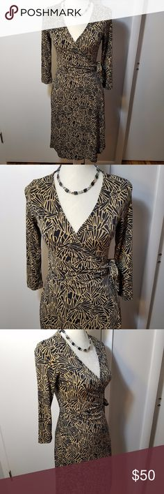"""BCBG Max Azria Tan & Black Long Sleeve Wrap Dress Excellent pre-owned condition. Inside panel belt loops through belt hole and ties around the back at the left side. Sleeves are 18"""" long, full measurements are in the picture. Soft and flowy polyester-spandex, stretches well. Colors are tan and black. BCBGMaxAzria Dresses Long Sleeve"""