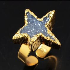 Blue druzy star gold ring Sparkle like a star with this adorable natural gemstone druzy geode ring. Deep blue druzy is cut into the shape of a star. Size 7.5, but adjustable to fit all sizes 6-10. Can be adjusted up or down to fit your ring size. Size:24x20x7mm You will receive the exact ring as the picture. Set in high quality goldtone metal which resists fading. Jewelry Rings