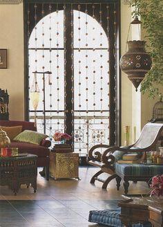 I see subtle jali. Contemporary Indian living room. Photo Mark Caparosa
