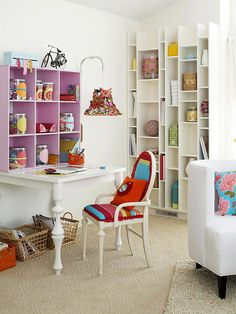 I am trying to create space for an office area in a small den. Love the idea of a bookcase on top of the desk.
