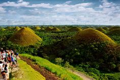 Travel to the Chocolate Hills.    (note: not actually made out of chocolate)