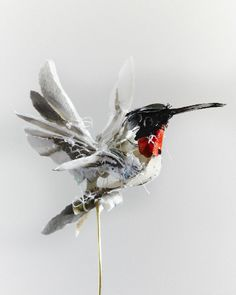 Torn paper sculpture  by Anna Wili Highfield Hummingbird 2013 30cm x 11cm x 12cm