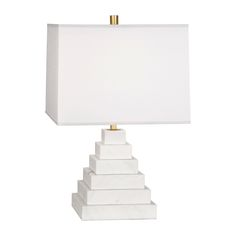 Elemental Elegance.Inspired by Mesopotamian pyramids known as ziggurats, our Canaan Pyramid Table Lamp features clean blocks of marble stacked in a tapering form. An antiqued brass stem and perforated metal diffuser add a twinkly touch to an otherwise clean, modern design. Fab in pairs anchoring an entryway console. Available in black Marquina marble with a white or black linen shade or in white Carrara marble with a white or grey linen shade.