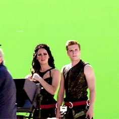 BTS: Catching Fire Behind The Scenes Photo. I love how jen is just stroking her pretty hair (: