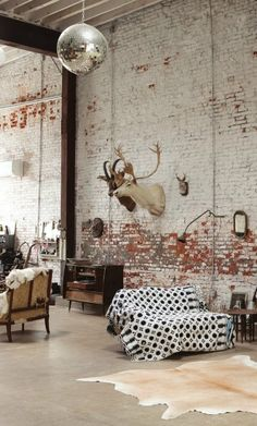 Taxidermy and distressed brick.