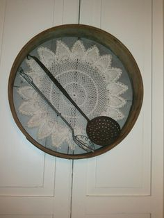 Old sifter with a doily made by my Mother.