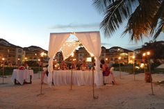 Belize Wedding Gallery, Intimate wedding, White Wedding Decor, Beach Reception, Grand Caribe, Tiki Torch wedding. Destination Wedding.