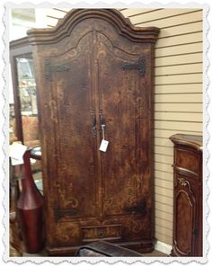 This beautiful wood armoire is so charming.  It is great to organize the clutter in our homes.