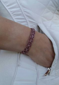 Macrame bracelet with triangle design o This listing is for 1 bracelet o Bracelet fits wrist from 5 1/2 to 9. o Bracelet width measures about 1/2. o This bracelet is 100% handmade o Water resistant o Keep away from bleach *** (I ship international registered mail. Your bracelet will