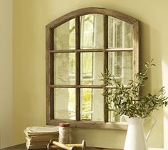 mirrors = the next best thing to windows. love the shape & character of this one.