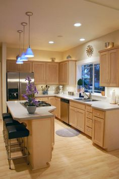 this kind of looks like my kitchen but without the island...so maybe an island would fit!