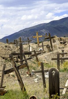 Old cemetery in Taos, New Mexico  I get a sense of peace and sad nostalgia visiting old cemetaries.