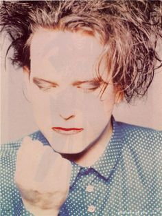 Robert Smith in a blue shirt