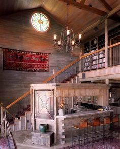 Bar and stairway of rustic new home built using recycled antique materials. Another Truehome Design-Build project designed by Sentient Architecture, LLC.