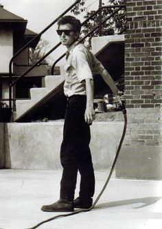 Bob Dylan practicing with his bullwhip, Rhode Island 1963. Photo by David Gahr.