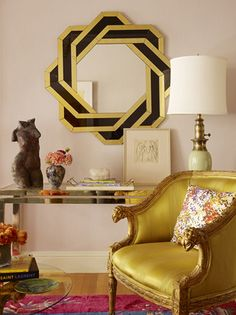 Gorgeous re-upholstered chair, vintage mirror and lamp...love the vintage vibe of the colours too!