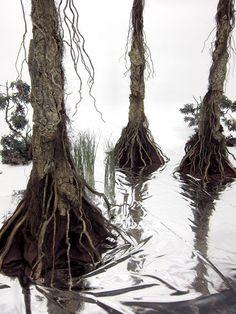 Use Mylar sheets to make fake swamp water: