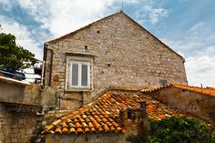 Old House in Dubrovnik, Croatia ...  adriatic, aged, ancient, architecture, balkan, blue, bricks, buildings, city, cityscape, clay, clouds, cover, croatia, cultural, dalmatia, dubrovnik, europe, grunge, historical, home, house, landmark, medieval, mediterranean, old, old orange, outside, overlap, protection, red, roof, roofing, rooftop, rough, row, sky, stones, striped, structure, style, summer, terracotta, tile, tourism, town, travel, urban, window